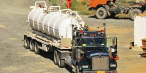 A vacuum truck used to transport drilling fluids (drilling mud) to the drilling rig site.